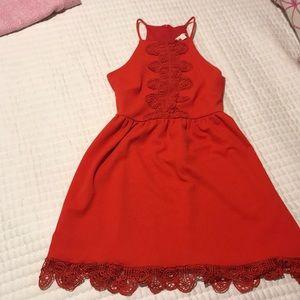 Francesca's red lace dress